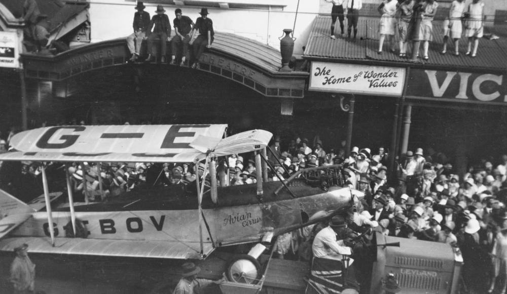 StateLibQld_1_123500_Bert_Hinkler's_Avro_Avian_aeroplane_paraded_in_Queen_Street,_Brisbane,_1928